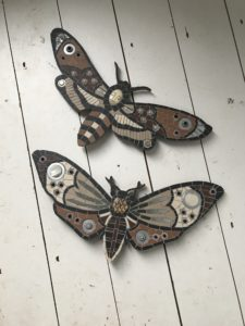 death head and mirrored moth mosaic art
