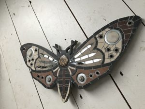 mirrored moth mosaic art
